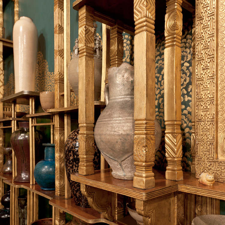 Whistler gilded the walnut latticework forming the shelves.
