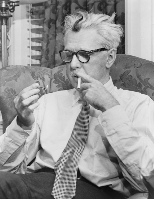 American author James Thurber smokes a cigarette