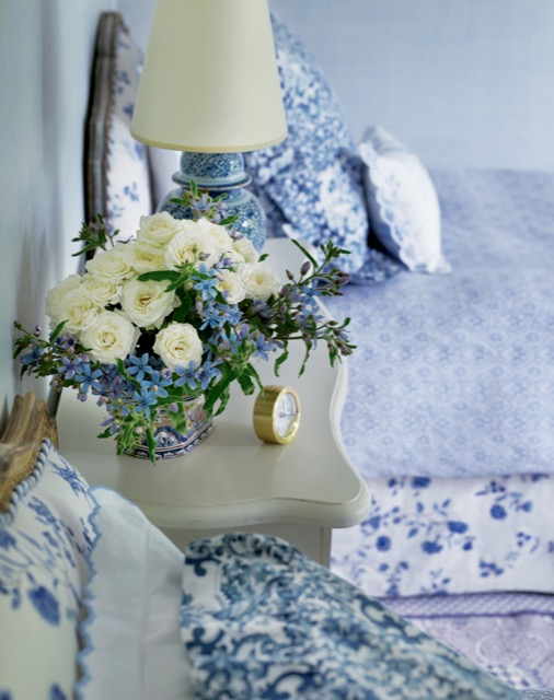 A romantic bouquet graces a bedside table in Charlotte Moss's Garden Inspirations.