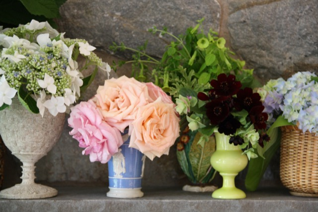 Bouquets arranged by Charlotte Moss in a collection of her vases.