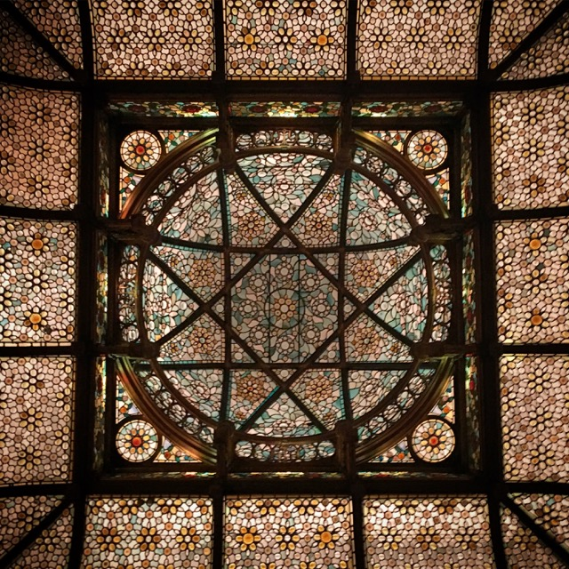 The luminous stained glass dome in the bar area of The National Arts Club in New York City.