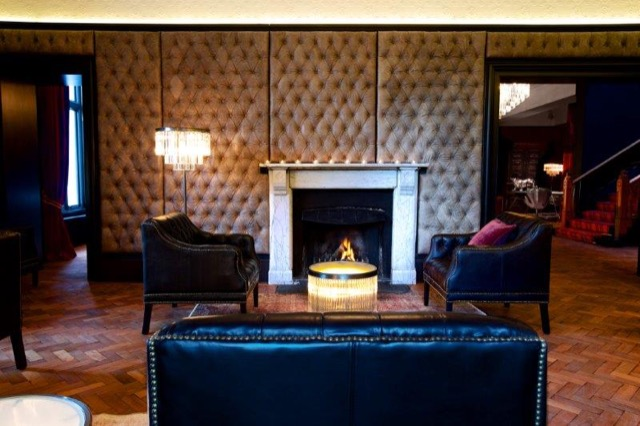 The bar, set with a blazing fireplace, at the Glazebrook House Hotel