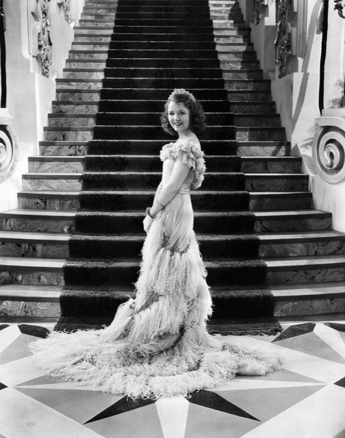 Janet Gaynor in a lovely feathering gown