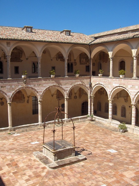 The courtyard of the friary at the Basilica of St. Francis of Assisi where one can experience more
