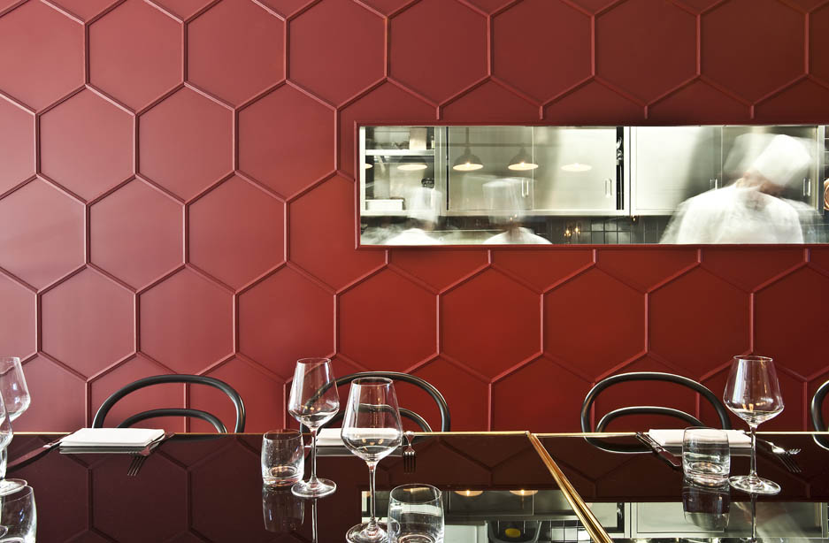 A red honeycombed wall treatment at Le Vrai in Milan