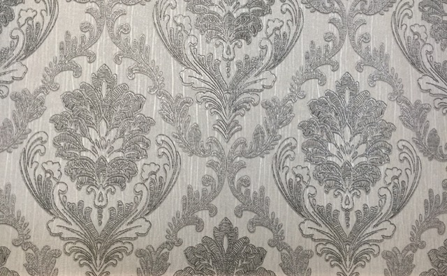 A damask pattern by Graham & Brown seen at Heimtextil
