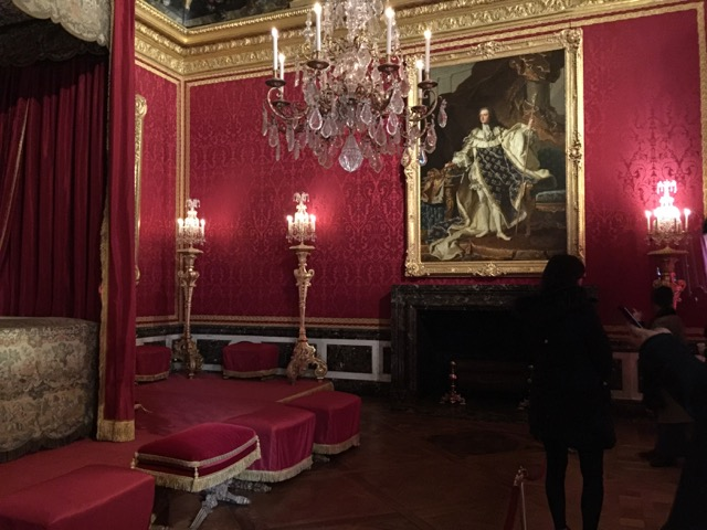 A portrait of Louis XV in the Salon de Mercury at Versailles