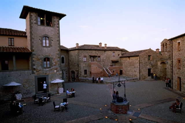 The piazza at Castel Monastero with a medieval personality