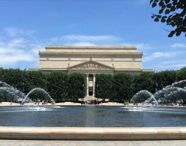 The National Gallery of Art beyond a fountain, photographed from the sculpture garden. Image © Saxon Henry.