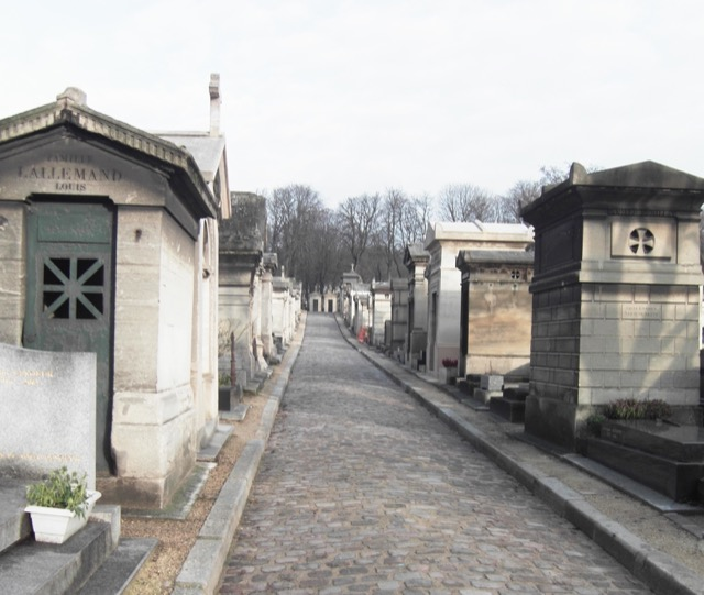 A path of pavers leading through the tombs in the Père Lachaise Cemetery. Image © Saxon Henry.