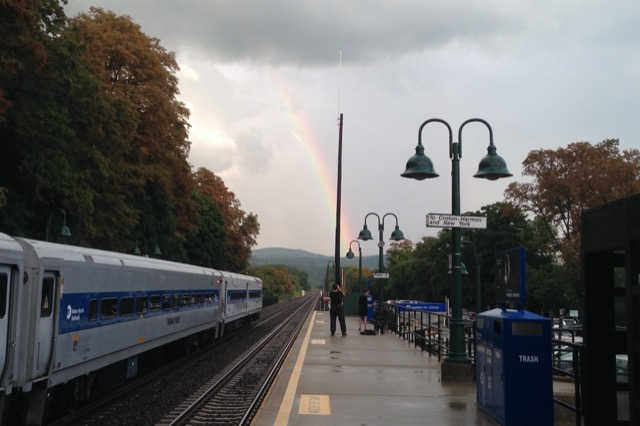 A rainbow arcs over the train tracks of the Hudson River Line. Image © Saxon Henry.