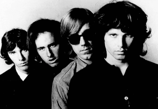 The Doors (front to back): Jim Morrison, Ray Manzarek, Robby Krieger, and John Densmore.