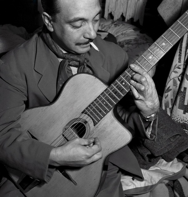 Django Reinhardt making musical magic even with his maimed right hand.