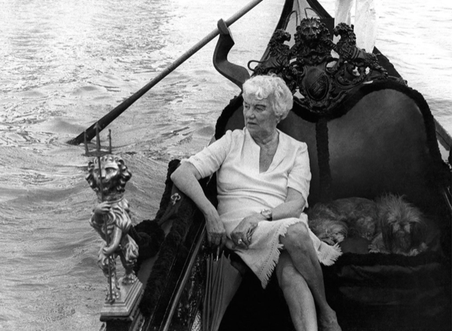 Peggy Guggenheim and her dogs in her private gondola. Image courtesy The Solomon R. Guggenheim photo archives.