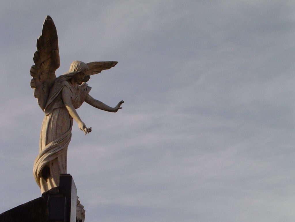 An angel in the Recoleta Cemetery in Buenos Aires. Image © Saxon Henry.
