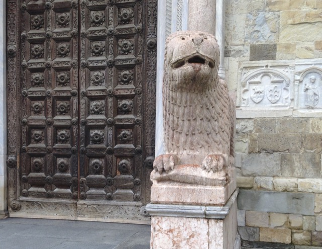 Medieval lions guard the Parma Cathedral. Image © Saxon Henry.