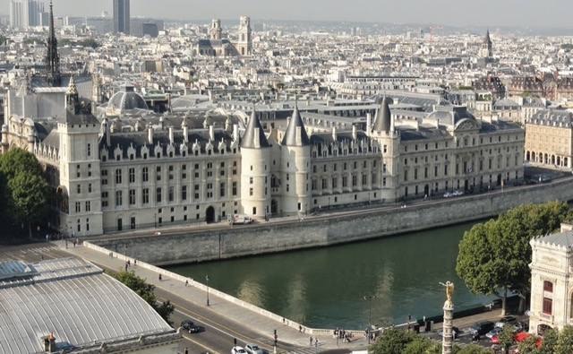 The Palais de la Cité complex on the Île de la Cité would now cover the spot where the palace was located during Julian's time, the towers along the Seine and the spire of Sainte-Chapelle to the left remnants from medieval times. Image courtesy WikiMedia and Yann Caradec.