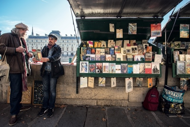 One of the famed Paris Bouquinistes, bookstores in miniature along the Seine. Image © Horst A. Friedrichs.