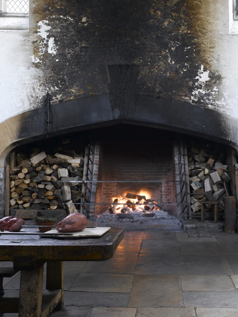 The great roasting fire where meat was cooked on a spit in the medieval kitchen at Hampton Court Palace. Image courtesy Historic Royal Palaces.