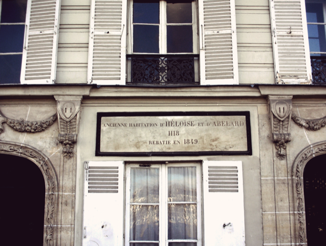 The sign on the house where Abélard seduced Héloïse in 1118 notes the original structure was replaced in 1849.