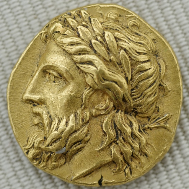 A laurel-wreathed head of Zeus on a gold stater, Lampsacus, c 360–340 BC (Cabinet des Médailles), one of the pagan gods. Image courtesy of WikiMedia and Jastrow.