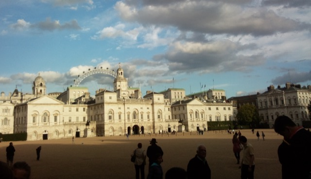 The Horse Guards Parade with the London Eye Ferris wheel in the background. Image courtesy WikiMedia and George Tsiagalakis.