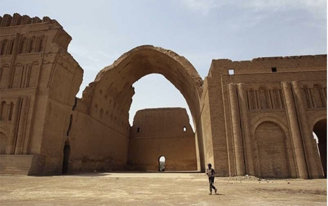 The Taq-i Kasra, the archway to Ctesiphon, is the only remaining structure of the ancient city that would have been in place when the pagan Julian was slain there. Image courtesy Noise Break.