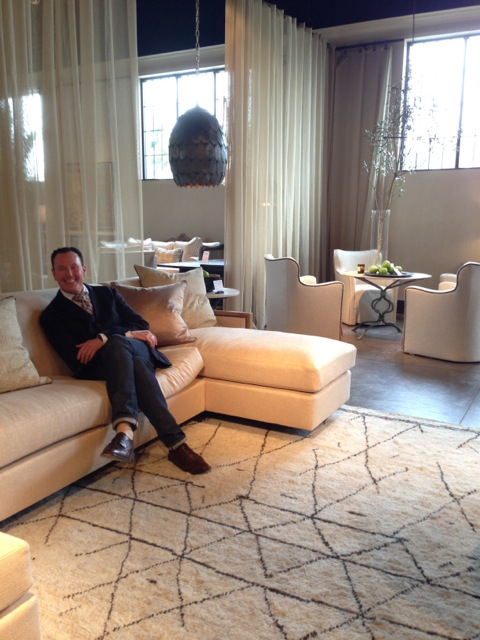 Barry Dixon seated on his Aloysius sectional.