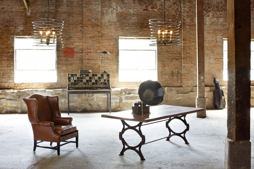 The Factory Table and Kingwood Chair by Currey and Co.