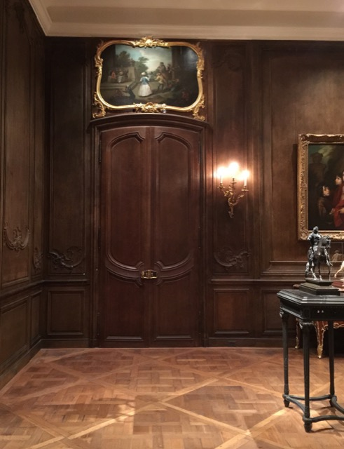A room clad in boiserie from La Château de la Norville, now in the Widener Room at NGA.