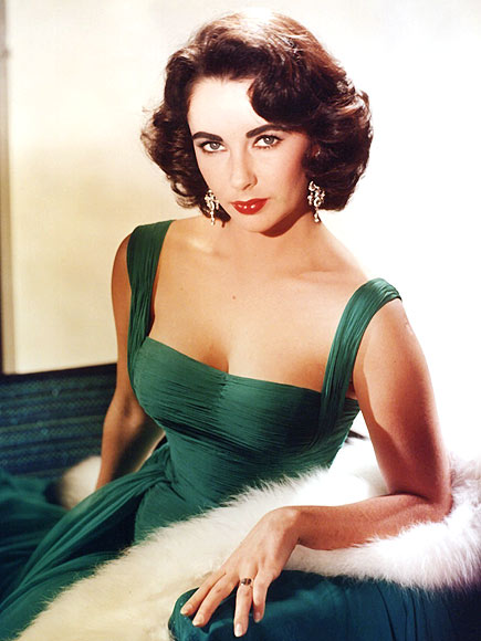 Elizabeth Taylor in a green couture gown, the epitome of style