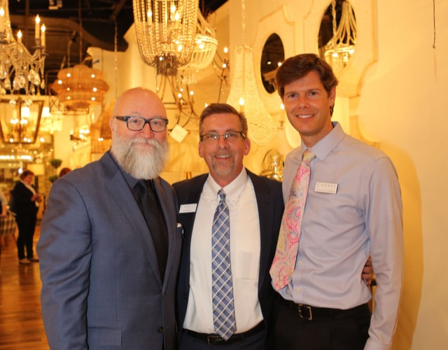 Cecil Adams, Bob Ulrich and Jonathan Freeman of Currey & Company during spring High Point Market. Photo by Beth Tilley Green.
