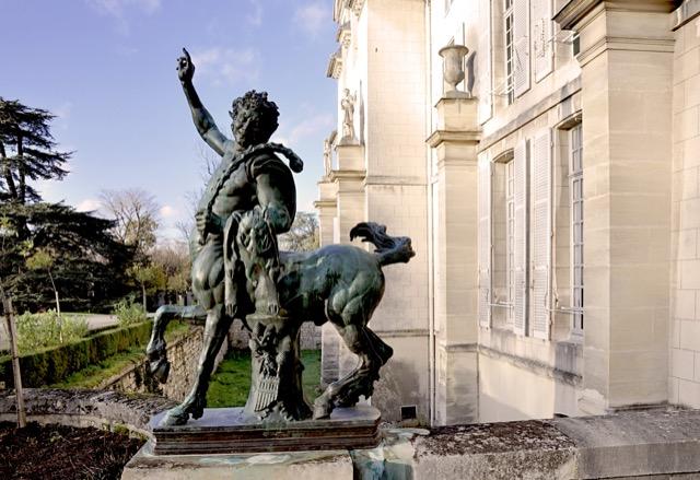 A Centaur poses outsideChâteau de Malmaison